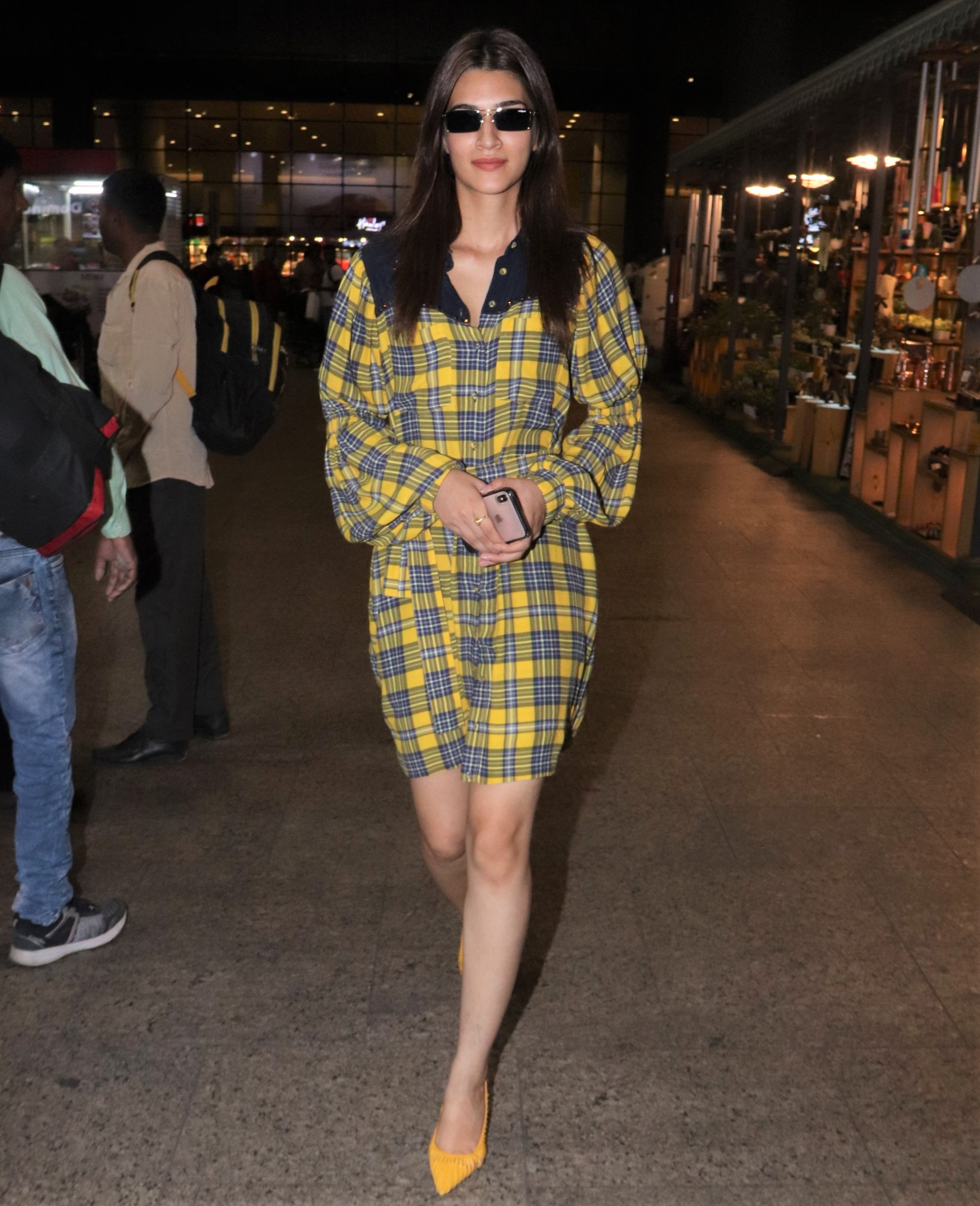 Kriti Sanon Wins Airport Fashion With a Yellow Plaid Dress