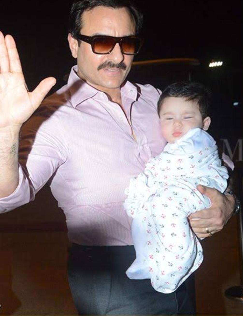 Taimur Ali Khan with Saif Ali Khan at the airport