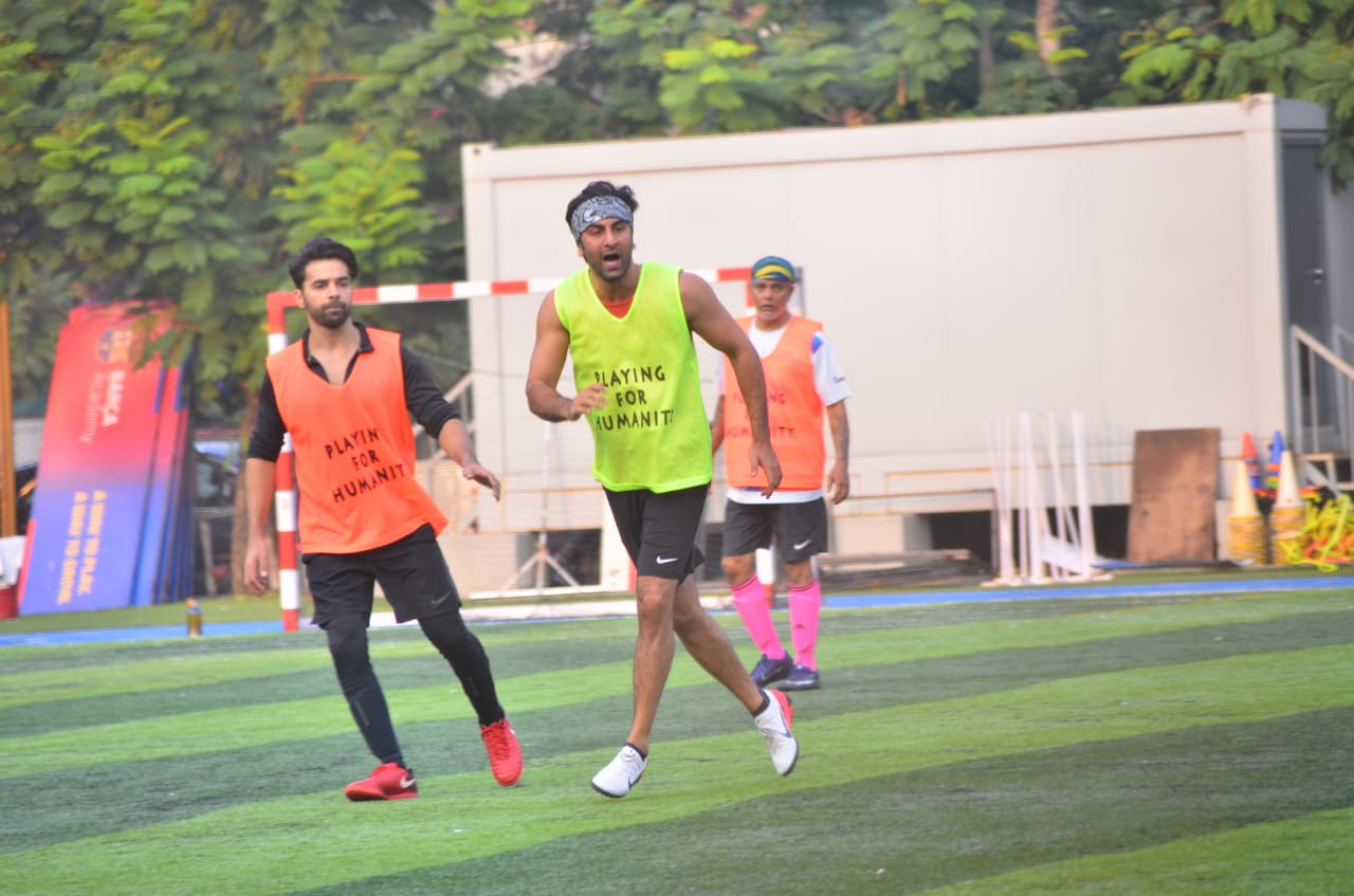 Ranbir Kapoor playing football along with other celebs