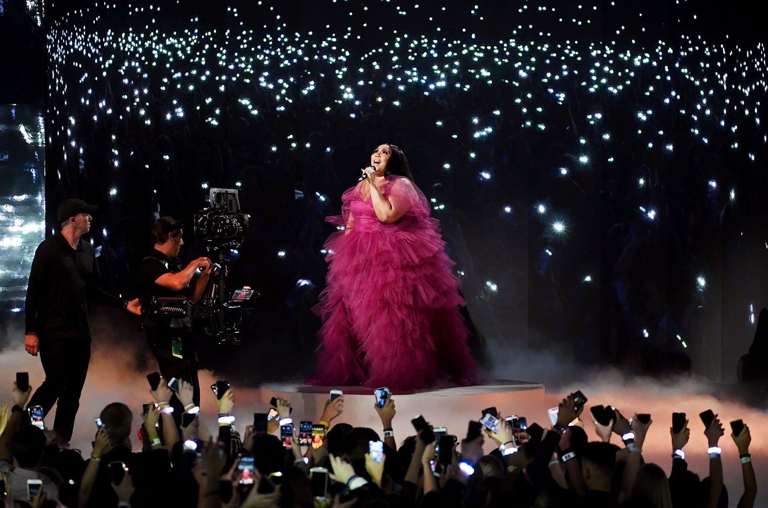 Lizzo performing at the AMAs