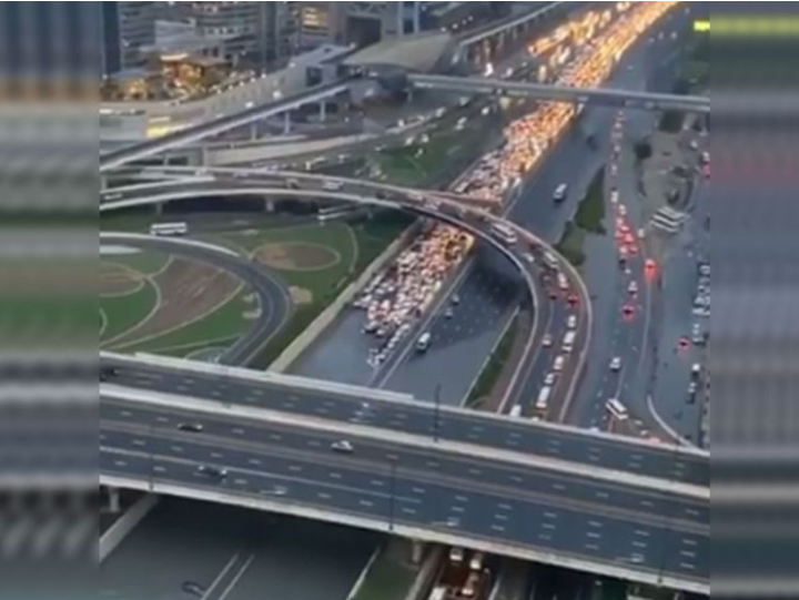 Traffic built up in the flooded part of the Dubai Mall interchange on Saturday