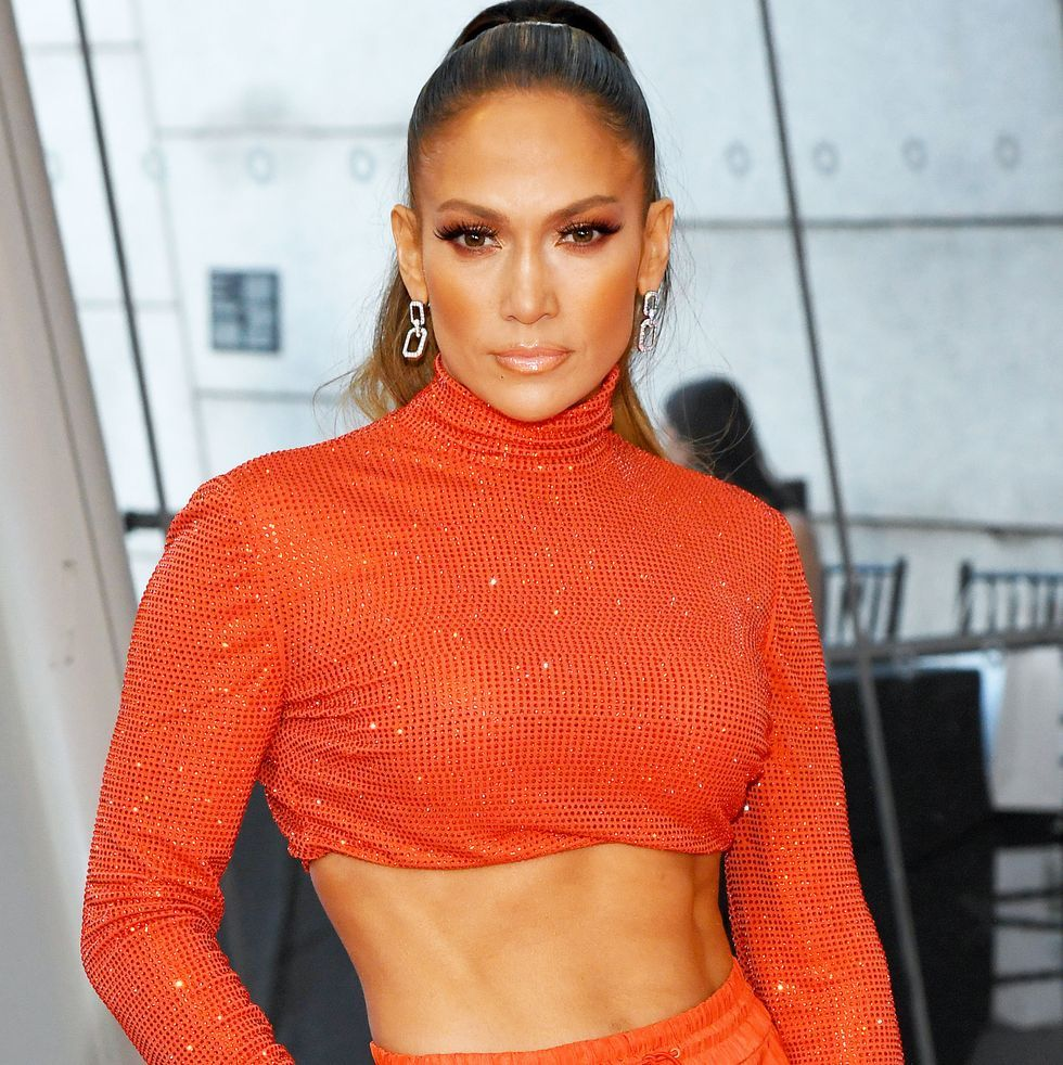 Jennifer Lopez flashes her toned abs