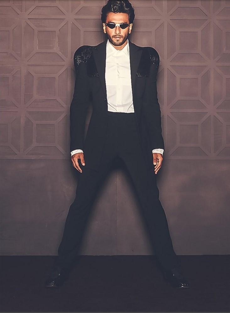 Ranveer Singh exuding glamour in a black suit