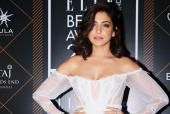 Anushka Sharma graces the red carpet in an off-shoulder white sheer gown