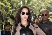 Varun Dhawan, Nora Fatehi Spotted at the Airport