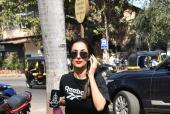 Malaika Arora Sports a Red Pout with Laid Back Look
