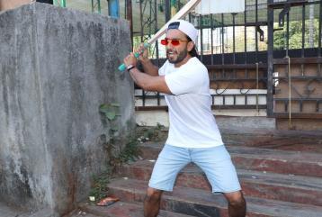 Ranveer Singh Swings a Bat in Dapper Attire