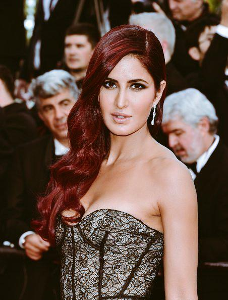 With flaming red hair and couture gown by Oscar De La Renta, Katrina Kaif made many heads turn on the red carpet during her debut walk at the 68th Cannes Film Festival 2015