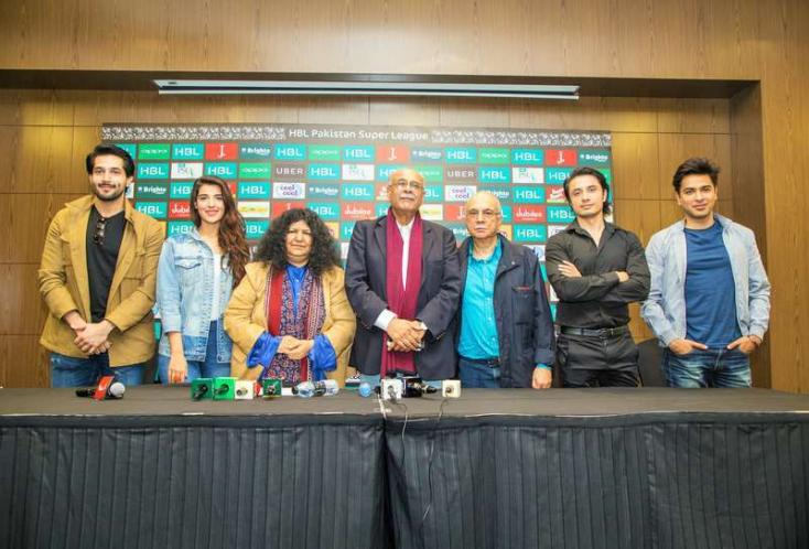 The artists pose for the cameras during the press conference