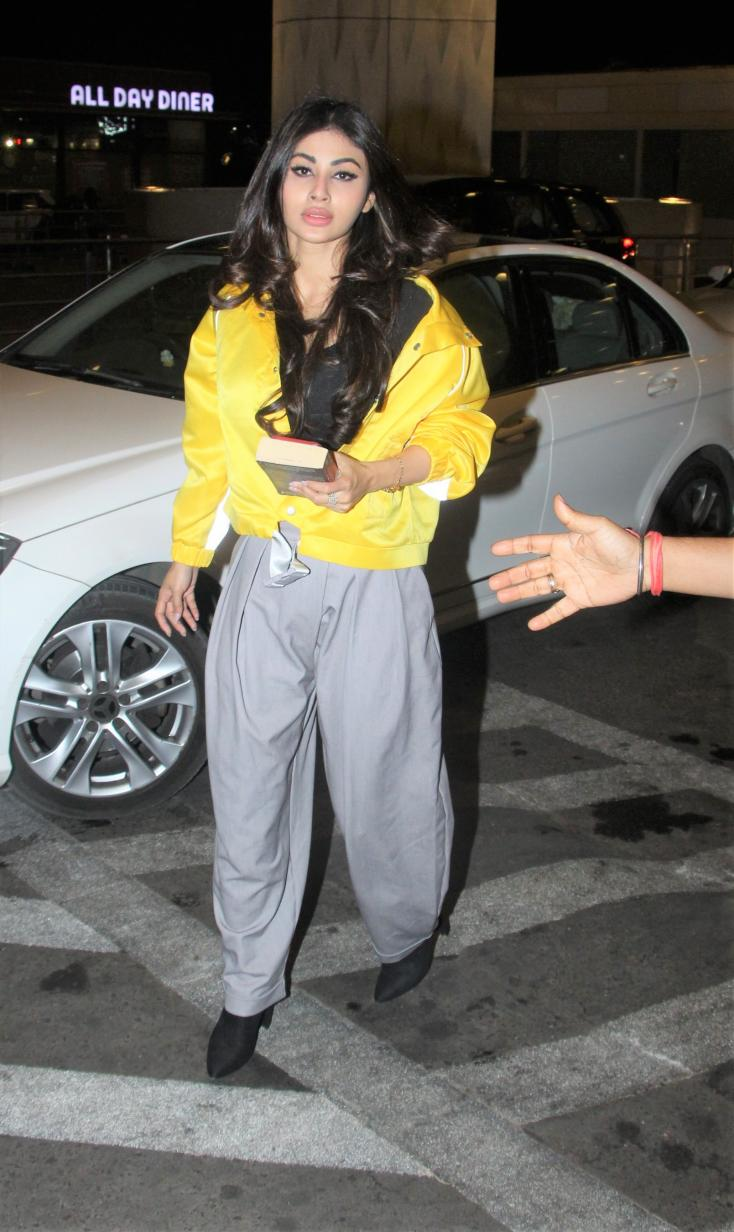 Mouni Roy rocking it at the airport with the bright yellow jacket