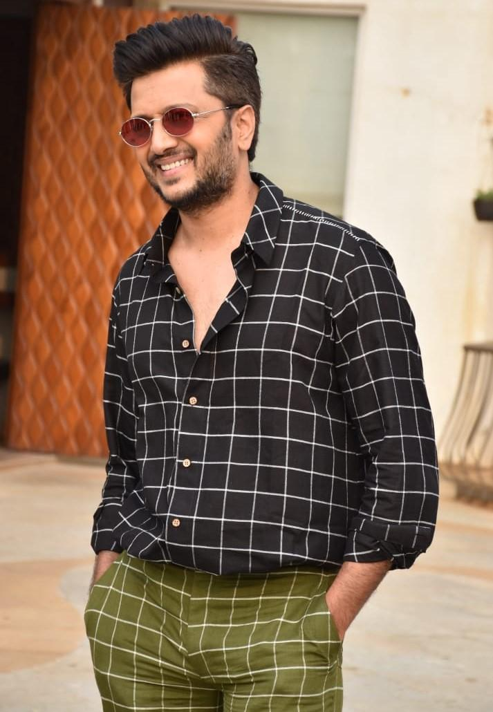 Riteish Deshmukh smiles wide for the camera's at the promotional photoshoot.