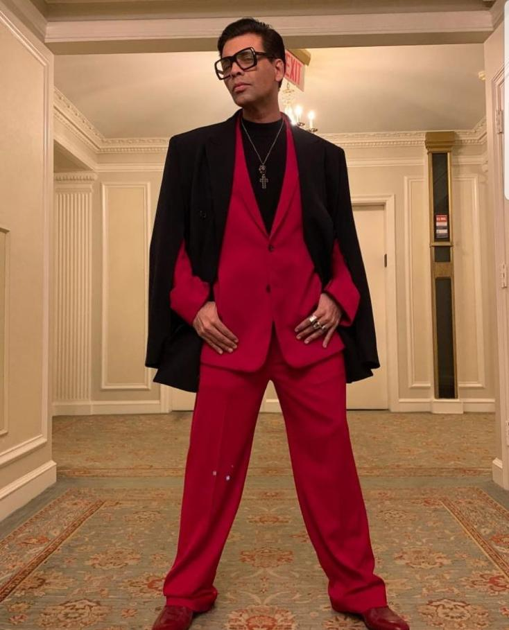 Karan Johar Heads for Emmy Awards in New York in a Red Suit