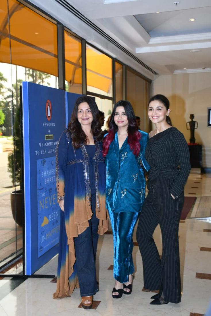 Pooja Bhatt, Shaheen Bhatt, and Ali Bhatt smile wide for the cameras at the book launch.
