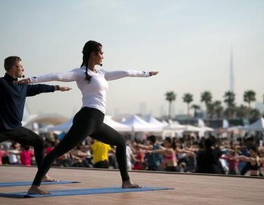 IN PICS: Esha Gupta's Yoga Poses with 2000 Dubai Yoga Fans
