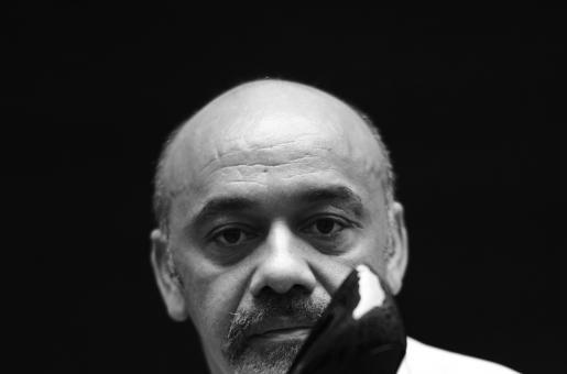 The Story Behind Christian Louboutin's Iconic Red Sole