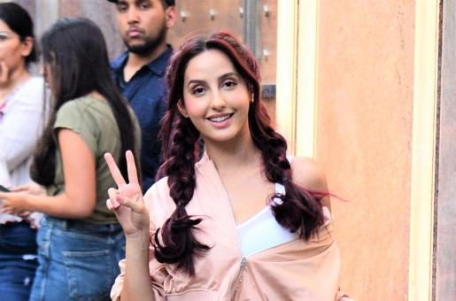 Nora Fatehi Is Adorable In Pink and Braided Pigtails!