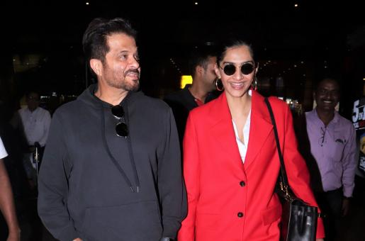 Sonam Kapoor is Dazzling in Red at the Airport with Father Anil Kapoor