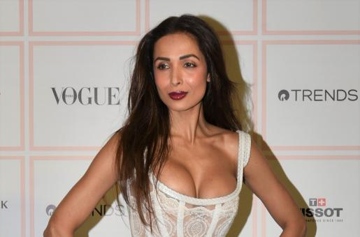 Malaika Arora Turns Heads In Fiery Gown At Beauty Award Show