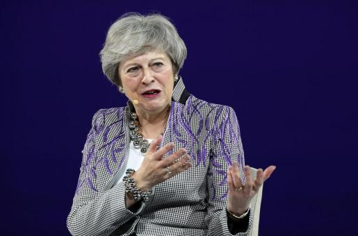 Theresa May Shares Inspirational Messages at Women's Forum in Dubai