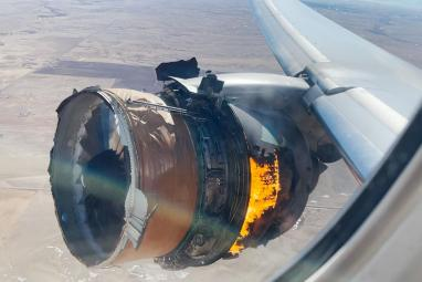WATCH: Passenger records plane engine catching fire as debris falls to the ground