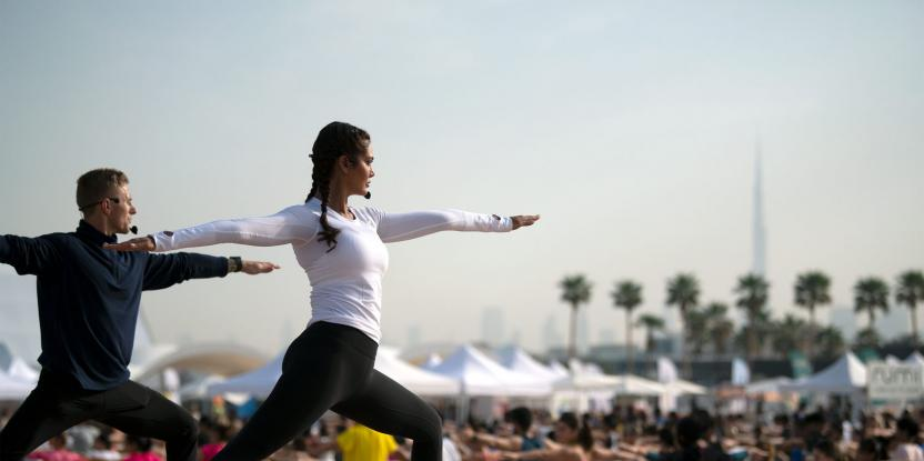 IN PICS: Esha Gupta's Yoga Poses with 2000 Dubai Yoga Fans